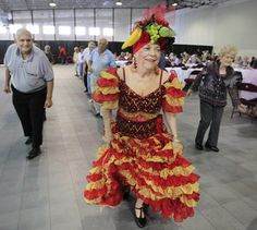 Dressed as Carmen Miranda, Evelyn Cancella of Metairie joins in a line dance during the Jefferson Parish Senior Citizens dance at the Alario Center in Westwego. --Susan Poag, The Times-Picayune