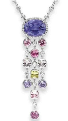 A DIAMOND AND MULTI-COLORED SAPPHIRE NECKLACE, BY TIFFANY & CO.   Suspending a cushion-cut purple sapphire, weighing approximately 8.21 carats, within a circular-cut diamond surround, suspending a collet-set diamond and multi-colored sapphire tassel, to the collet-set diamond neckchain, mounted in platinum, 17¾ ins.  Signed Tiffany & Co., no. 21637041