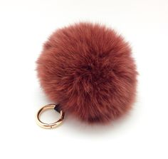 A personal favorite from my Etsy shop https://www.etsy.com/listing/468731972/colorful-real-fox-fur-key-chain