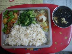 Taiwan. Sweet and sour pork with pineapple, radish, carrots and green pepper, middle: vegetable stir fry with garlic, on the right: fish ball stew with cabbage, carrots and wood ear mushroom, and soup: seaweed and egg drop.