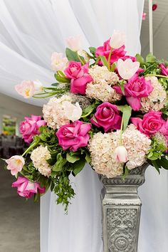 beautiful pink and white centerpiece with a little greenery! white hydrangeas, white tulips, hot pink roses and greens