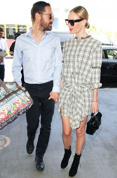Kate Bosworth wears a plaid dress with black booties and a black Christopher Kane bag.
