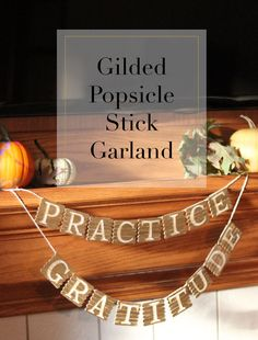 Convert popsicle sticks to a garland for fall