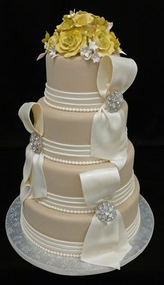 Champagne Swag Bling Wedding Cake.. I would change yellow flowers to beige or cream~