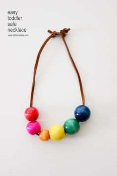 DIY Toddler Safe Necklaces. They are fun to make and with a unique clasp they are safer for little ones.  || Delia Creates
