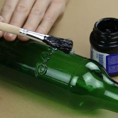 How to turn old bottles into amazing vases - Wine Bottle Art, Glass Bottle Crafts, Lighted Wine Bottles, Diy Bottle, Bottles And Jars, Glass Bottles, Alcohol Bottle Crafts, Bottle Painting, Diy Home Crafts