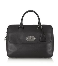 From Plane Chic: Inspired Airport Looks from Stylish Travelers  Tom Ford Buckley leather duffel bag, small, $3,460