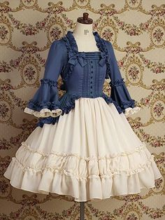 Gorgeous lolita dress with the dark navy blue on the upper torso and the white ruffles on the lower torso.