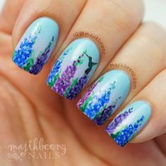 Delphinium with a hummingbird nail art by @majikbeenz