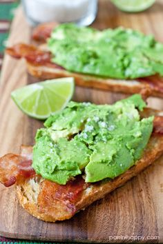 avocado bacon toasts with lime and sea salt . Yummy appetizer snack or sandwich Think Food, I Love Food, Good Food, Yummy Food, Tapas, Plat Vegan, Snacks Für Party, Le Diner, Bruschetta