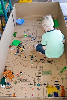 Cardboard box city plans for Legos and other toys.