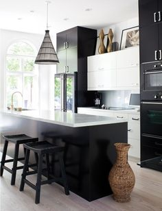 Contemporary Designer Kitchen    Positioning the white cabinets lower makes room for creative display on top.