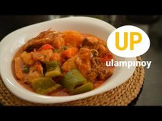 Tomato-based chicken #stew with carrots, red and green bell pepper, and potatoes. Watch the cook-along video #recipe