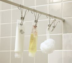 Put an extra rod along the back wall of the shower and hang stuff from it.