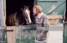 Drummer Ginger Baker poses for a photo with his horse circa 1975.