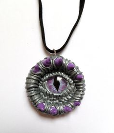 Mystical Silver and Pink Dragon eye pendant by AurorasLocket