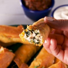 This cheesy appetizer combines two of our favorite things in the world: chicken taquitos + spinach-artichoke dip. Beware, on game Appetizer Recipes, Appetizers, Spinach Stuffed Chicken, Clean Eating Snacks, Mexican Food Recipes, Thai Recipes, Salad Recipes, Chicken Recipes, Finger Foods