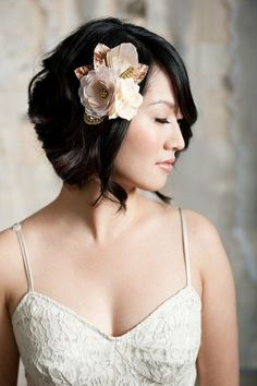 Short loose updo with floral at the front. Wedding Hair Style