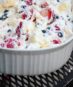 Red White and Blue Fruit Salad with Coconut Milk Whipped Cream... perfect as a healthy dairy-free 4th of July treat