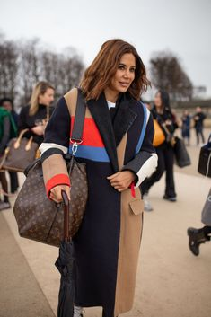 PARIS, FRANCE - JANUARY 17: Christine Centenera is seen attending Louis Vuitton during Mens Paris Fashion Week AW19 wearing Louis Vuitton coat and bag on January 17, 2019 in Paris, France. (Photo by Matthew Sperzel/Getty Images)