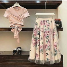 Floral print skirt and crossed top PRICE - AVAILABLE in size S, M and L You can send us a Direct Message or click the link in our bio to contact us via WhatsApp on Same day delivery within Lagos days delivery outside Lagos. Fashion Wear, Love Fashion, Fashion Outfits, Womens Fashion, Fashion Design, Fashion Fashion, Beautiful Outfits, Cool Outfits, Floral Print Skirt
