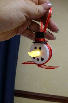 This is made from a battery operated tea light, I don't have any instructions but I'm sure all of you crafty people can think of something, #christmas, #snowman #light