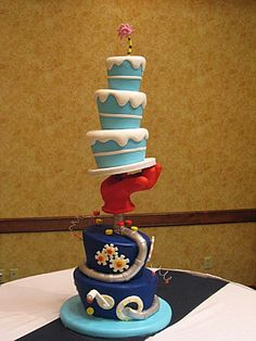 Seuss Wedding Cake Everything is cake. except for the glove which is styrofoam and modeling chocolate. There is a central threaded. Pretty Cakes, Beautiful Cakes, Amazing Cakes, Cake Wrecks, Dr Seuss Cake, Dr Suess, Blue Cakes, Modeling Chocolate, Cake Boss