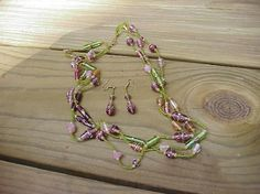 Handcrafted triple stranded glass necklace with earring, shades of green,pink, and purple