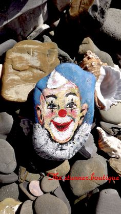 Will you smile back at me? #clown #painted rocks and more stunning colours on  https://www.facebook.com/pages/The-Stunner-Boutique/456809484484281
