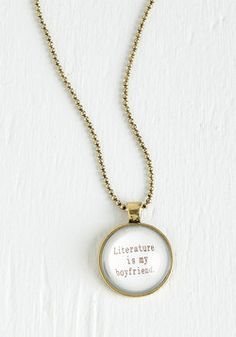 Taken with Tomes Necklace. If the novel in your hands isnt evidence enough, this bibliophile-inspired pendant is sure to prove your wordy adoration.  #modcloth