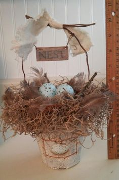 This lovely handmade, peat pot, nest basket is the perfect way to add a touch of nature to your home. It would also make a wonderful Easter, Mothers Day gift or a delightful gift for that special someone.  This peat pot has been crackled finished in ivory over brown to give a weathered look. A hand painted light blue speckled egg surrounded by birch limbs is painted on both sides of the pot, and the little wooden sign that hangs from the handle says nest on both sides, so this basket can be…