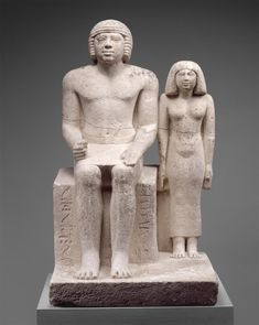 slate sculpture of menkaure and his queen from giza