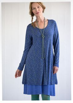 "GUDRUN SJÖDÉN – ""April"" tunic in micromodal/spandex Jersey tunic with beautiful drape and inverted front pleat, in the ""April"" print - a wonderful sketched pattern of leaves, balls and dots. Full-length sleeves and a slightly wider neckline."