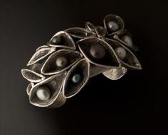 Cuff | Judy Perlman.  Sterling silver and pearls. by Olive Oyl