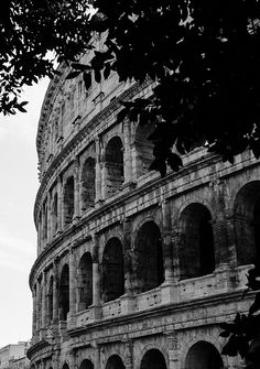Rome - The Colosseum in black and white by Andrea Mazzocchetti   the majesty of the Colosseum in Rome. The largest ancient amphitheater in the world and enduring symbol of the power of the Roman Empire.