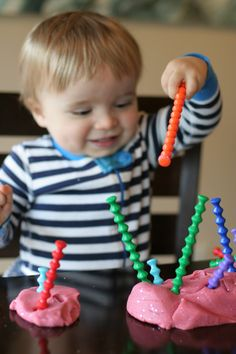 Tips and tricks for introducing playdough to babies and toddlers.  (Includes a link to our favorite homemade playdough recipe!)  From Fun at Home with Kids
