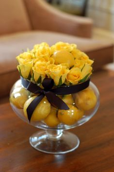 Same color mini-citrus topped with same hue and color of dense flower.