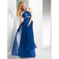 Crisp lines dance across this chiffon sheath gown. Intricate beading detail circles the baby doll waistband, intersected by twisting cross back straps and keyhole neckline. Zipper back closure.