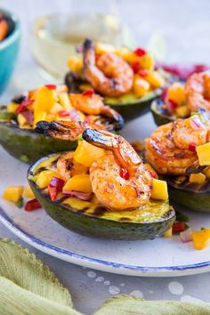 Stuffed Grilled Avocados with Grilled Shrimp and Mango Salsa - a healthy paleo appetizer perfect for grilling season