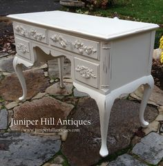 Yummy!  A pretty vanity/desk painted creamy white with scrumptious roses.