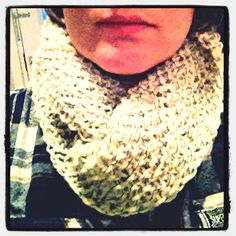 White wool mix with black thread binder, closure cowl.