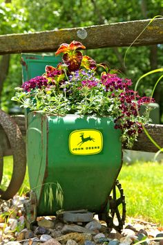 The best use of a John Deere planter!! Flower pots...
