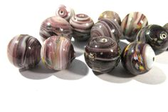 Lampwork VINTAGE Glass Beads Lampwork Twelve (12) Purple Swirl Marble Handmade End of Day Oval Beads Jewelry Beading Supplies (A143) by punksrus on Etsy