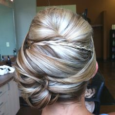 Braided unconventional side updo