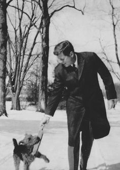 President John F. Kennedy and dog Charlie, 1960.