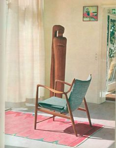 "Teak armchair designed in 1945 by Finn Juhl. Flat-weave rug designed and made in 1954 by Vibeke Klint. Wood sculpture by Erik Thommesen. From ""Scandinavian Domestic Design,"" Erik Zahle, 1968."