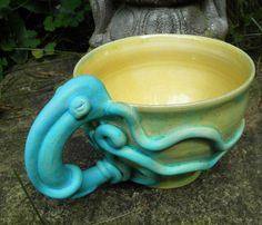 Gorgeous stoneware mug in mottled, chartreuse green yellow with a matte turquoise squid handle