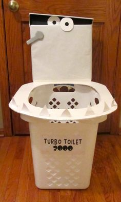 TURBO TOILET 2000… the Captain Underpants party favorite!  Made from a laundry basket, foam core, paper and white duck tape.  Teeth are just white card stock.   Party goers LOVED the chance to sling shot tidy whities (underwear) at it. Capt Underpants
