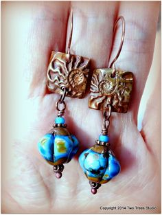 Dreams of Ancient Earth: Textured, colorful, and summery artisan copper and lampwork glass earrings.  By Two Trees Studio, $34.00.