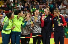 Silver medalists Agatha Bednarczuk Rippel and Barbara Seixas de Freitas of Brazil, gold medalists Laura Ludwig and Kira Walkenhorst of Germany and bronze medalists Kerri Walsh Jennings and April Ross of the United States celebrate on the podium during the medal ceremony for the Women's Beach Volleyball on day 12 of the Rio 2016 Olympic Games at the Beach Volleyball Arena on August 17, 2016 in Rio de Janeiro, Brazil.
